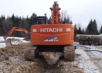 Terrassement fouilles pour canalisations réseaux humides